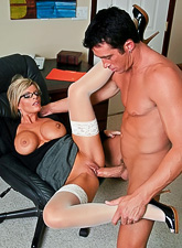 Hot blonde MILF whore shows us her huge jugs in the office as she fucks in stockings