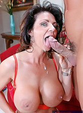 Seductive mature lady takes her red bar and exposes her jugs as she fucks hard.