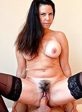 Classy big breasted brunette MILF strips her clothes and fucks in stockings.