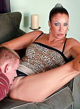 Busty brunette vixen takes her dress off and fucks younger dude in high heels.