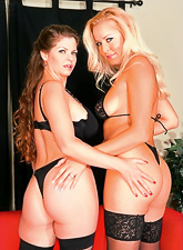 Classy MILF and her brunette friend fuck together in black lingerie and stockings.