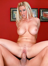 Busty blonde vixen takes her clothes off and slurps on large hard meat pole.