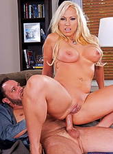 Busty blonde vixen takes her clothes off and slurps on her lover's hard meat pole.