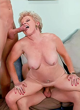 Horny old granny strips her clothes and gets double fucked by two big cocks.