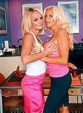 Lusty MILF and her slutty blonde lover share the same boner in front of the camera.