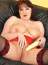 Chubby redhead momma with large beweeis wearing red lingerie playing with dildo