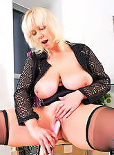 Mature blonde milf with huge beweeis wearing black lingerie playing with sex toy