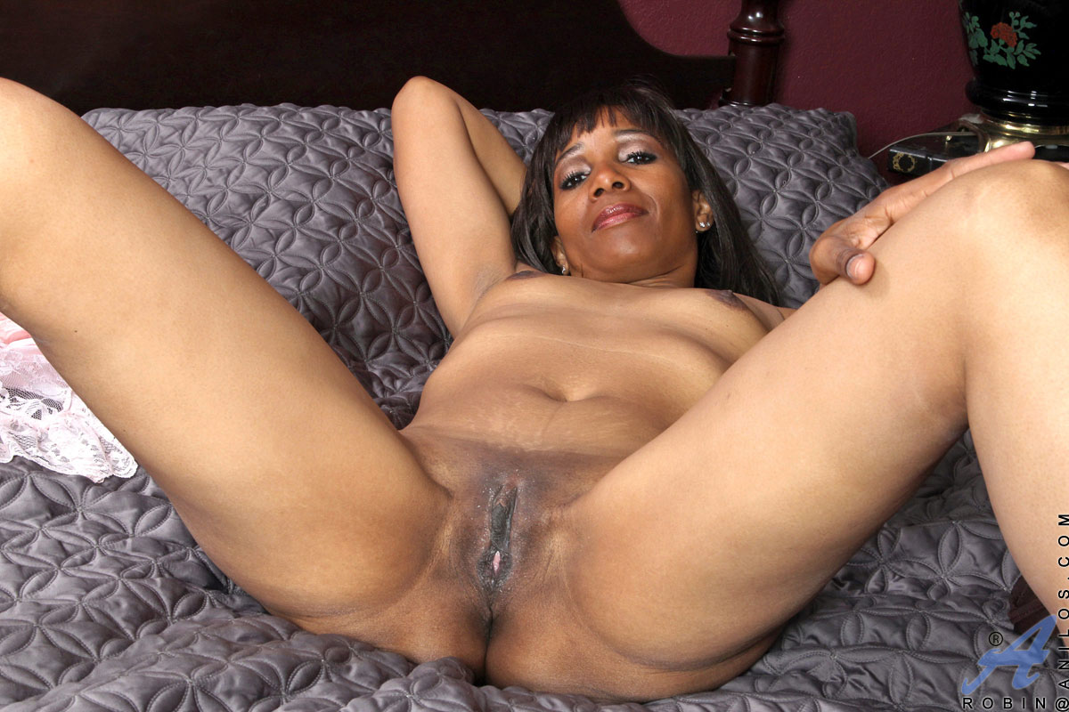 aroused ebony milf with small boobs and sexy booty sticking a dildo