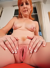 Randy redhead momma with big titties and hot butt wearing black thong revealing cunt