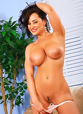 Busty brunette with tanned body wearing white thong sticking dildo up slippery cooter