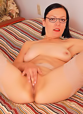 Horny brunette with nice boobies and glasses wearing white thong reveailng wet twat