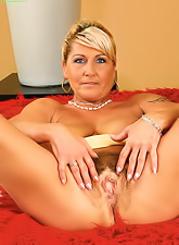 Hot blonde mature mama stripping and teasing with her hairy pussy and big saggy boobs