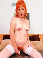 Hot ginger milf with a slim sexy body and delicious hairy pussy masturbating