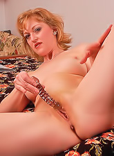 Hot mature sexy mama strips and stuffs her hairy pussy with a big kinky dildo