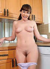 Sexy housewife gets horny in the kitchen and shows her pierced pussy and sexy boobs