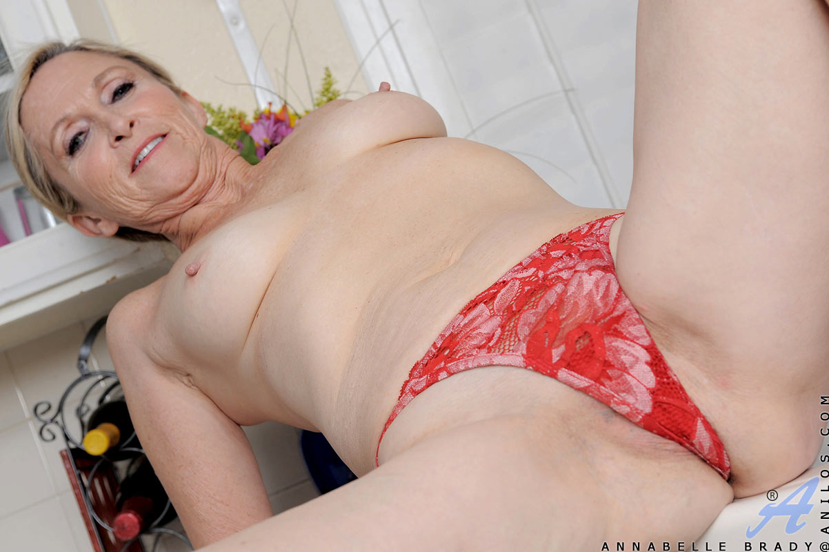 slutty granny in a hot red vintage bikini gets naked and all wet in