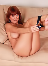 Hot redhead mature mama with gorgeous round tight boobs masturbating on a sofa