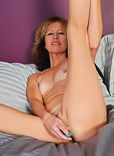 Kinky granny in sexy black lace stripping and masturbating with a kinky dildo