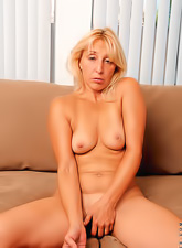 Hot blond milf with a tight body and hot saggy boobs plays with a kinky dildo