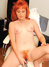 Hot and cute redhead babe gets rid of her sexy clothes and shows her nasty pussy