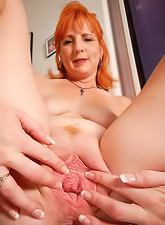 Sweet and sexy redhead babe gets off her dress and shows her nasty shaved pussy