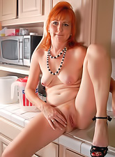 Sexy and cute redhead babe gets off her cute clothes and shows her beautiful body