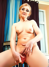 Hot and horny blond MILF gets off her undies and masturbates with her red dildo