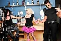Christie Stevens strips her pink skirt off and then gets screwed by two horny rockers