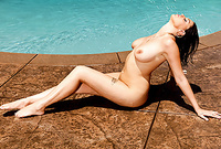 Nella Jay takes all of her clothes by the pool and teases us with her amazing breasts