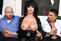 Joslyn James shows us her huge big jugs in kinky outfit as she strokes off two big throbbing cocks for the camera