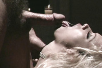 Jenna Jameson kneels before her handsome lover and passionately blows a throbbing piece of hard wood