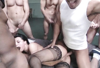 Belladonna takes all of her clothes before the camera and gets nailed by bunch of big cocks