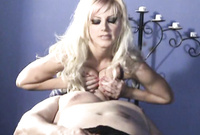 Brittany Andrews shows us her amazing big jugs as she gets titty fucked before the camera