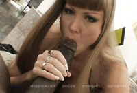 Darla Crane goes down on her knees and passionately blows a throbbing piece of hard wood