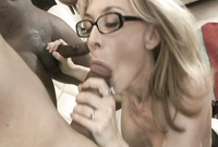 Nina Hartley and her slutty black friend strip together and strokes off big cocks