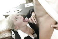 Kathy Anderson kneels before her dominant, handsome coworker and passionately blows his throbbing piece of meat