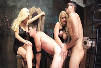Diamond Foxxx and Nikki Hunter stripr their slutty dresses in the dungeon and have kinky wild sex before the camera
