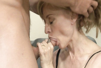 Nina Hartley screams passionately as she gets her hungry mouth drilled passionately by her lover's cock