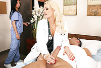 Monica Mayhem takes her sexy white coat off and then swallows her lover's big throbbing piece of wood