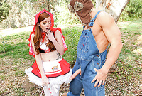Nikki Rhodes takes her slutty costume off in the woods and pleases her handsome lover with a killer blowjob