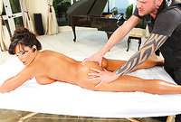 Lisa Ann lets tattooed bloke gives her a massage and ten bang her hungry muff witb his big stiff dong