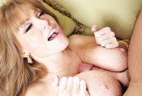 Darla Crane takes her classy black lingerie off and gets passionately titty fucked on the sofa
