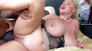 Samantha 38G is a chubby mature blonde with natural monster tits! She is horny as hell and satisfies her sexual needs with well hung black dude. Her bangs her hairy meaty pussy hard in the bedroom