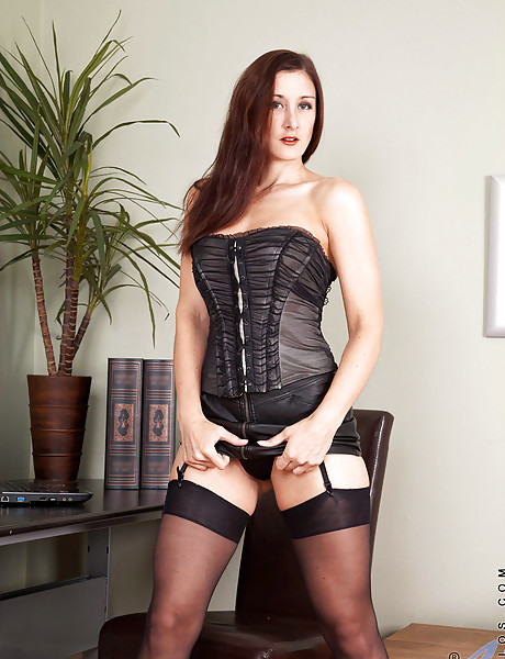 Classy brunette lady strips her expensive lingerie and plays in black stockings