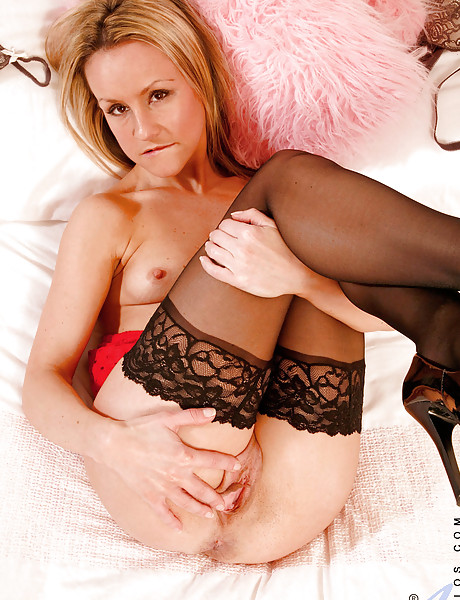 Alluring classy blonde hottie strips her sexy lingerie and plays with her vagina