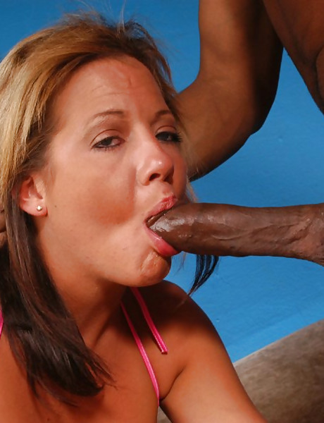 Big breasted mature whore kneels before her hung lover and sucks big black dong