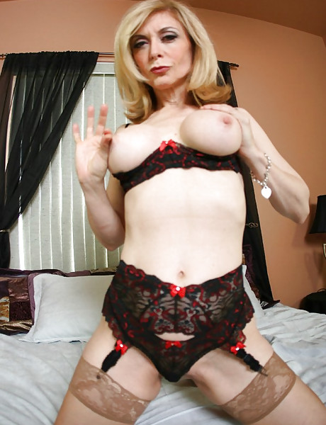 Classy and seductive MILF babe strips her black lingerie and fucks in stockings