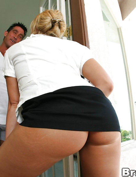 Foxy big breasted blonde babe kneels before her hung lover and slurps on his big dong