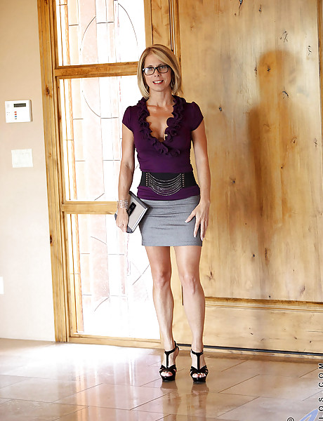 Foxy busty mature secretary takes her skirt off and teases us in sexy black heels