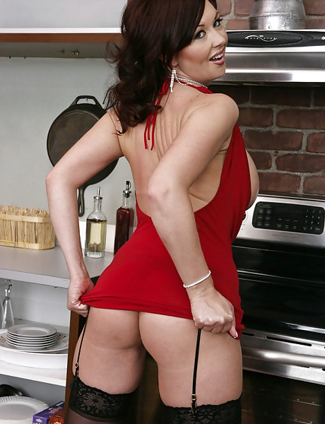 Classy mature vixen strips her tight red dress and gets screwed in black stockings